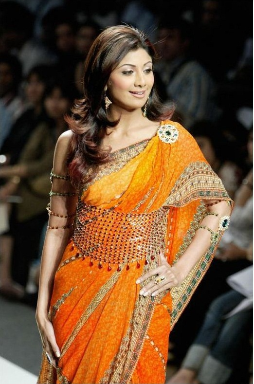 Shilpa Shetty wearing a saree with a beaded waist belt.