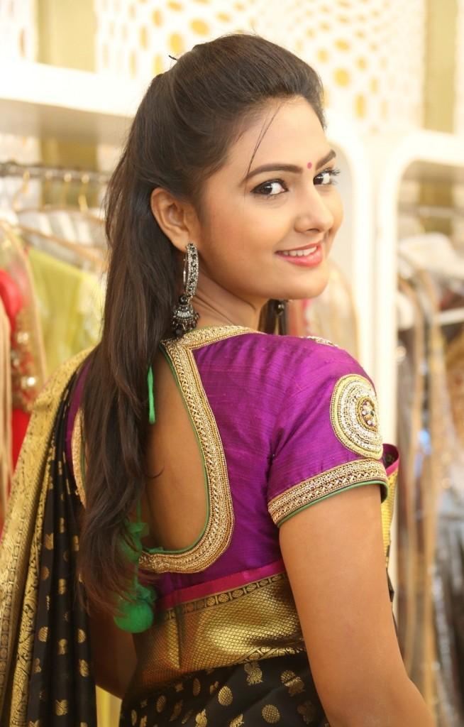 Neha Deshpande in pink pot neck blouse