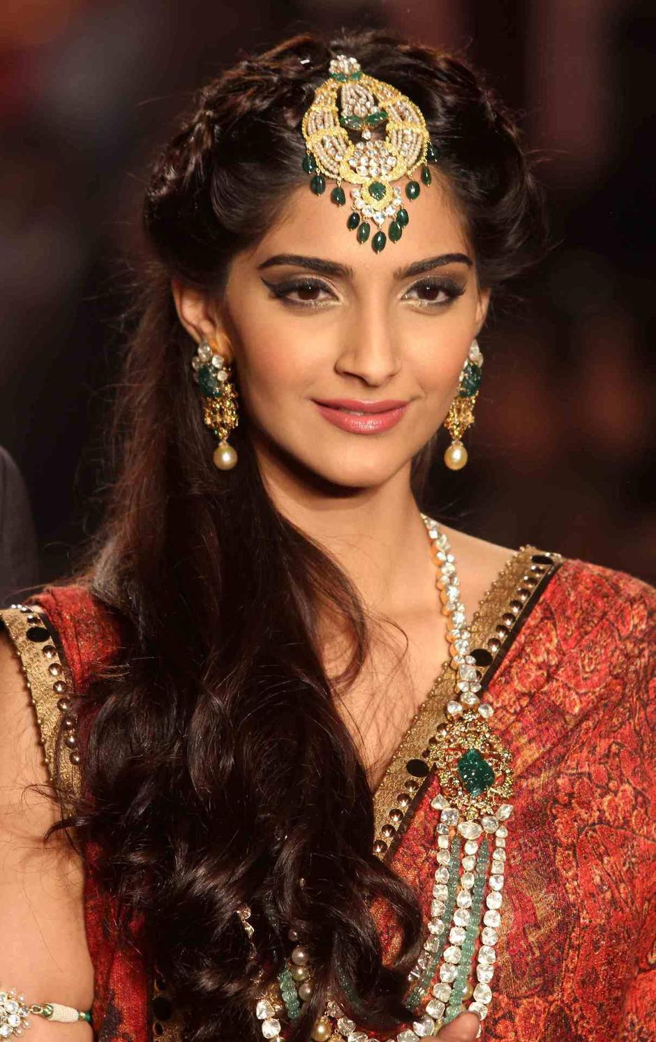 Sonam Kapoor wearing a saree with a forehead drop.
