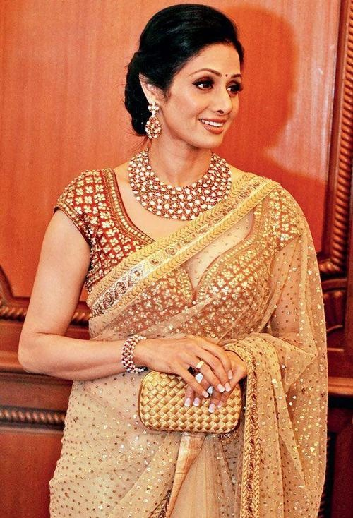 Sreedevi with ethnic clutch