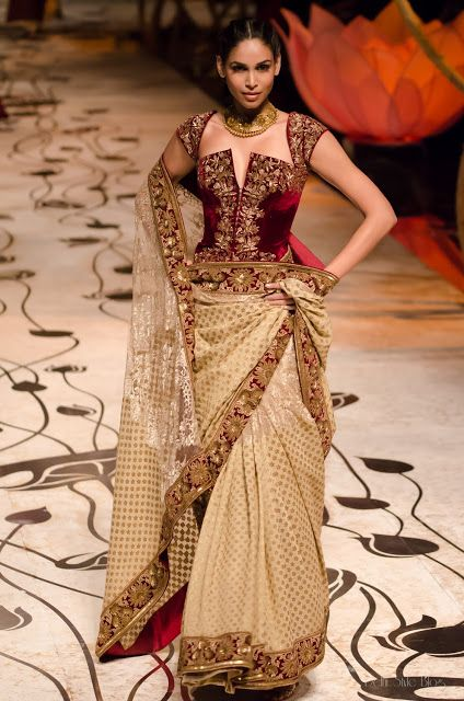 A golden and maroon lehenga
