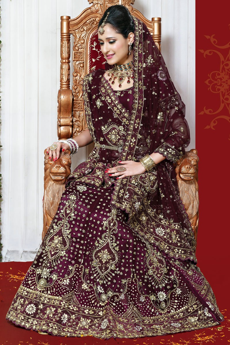 The model in Dark Bridal Lehenga Choli.