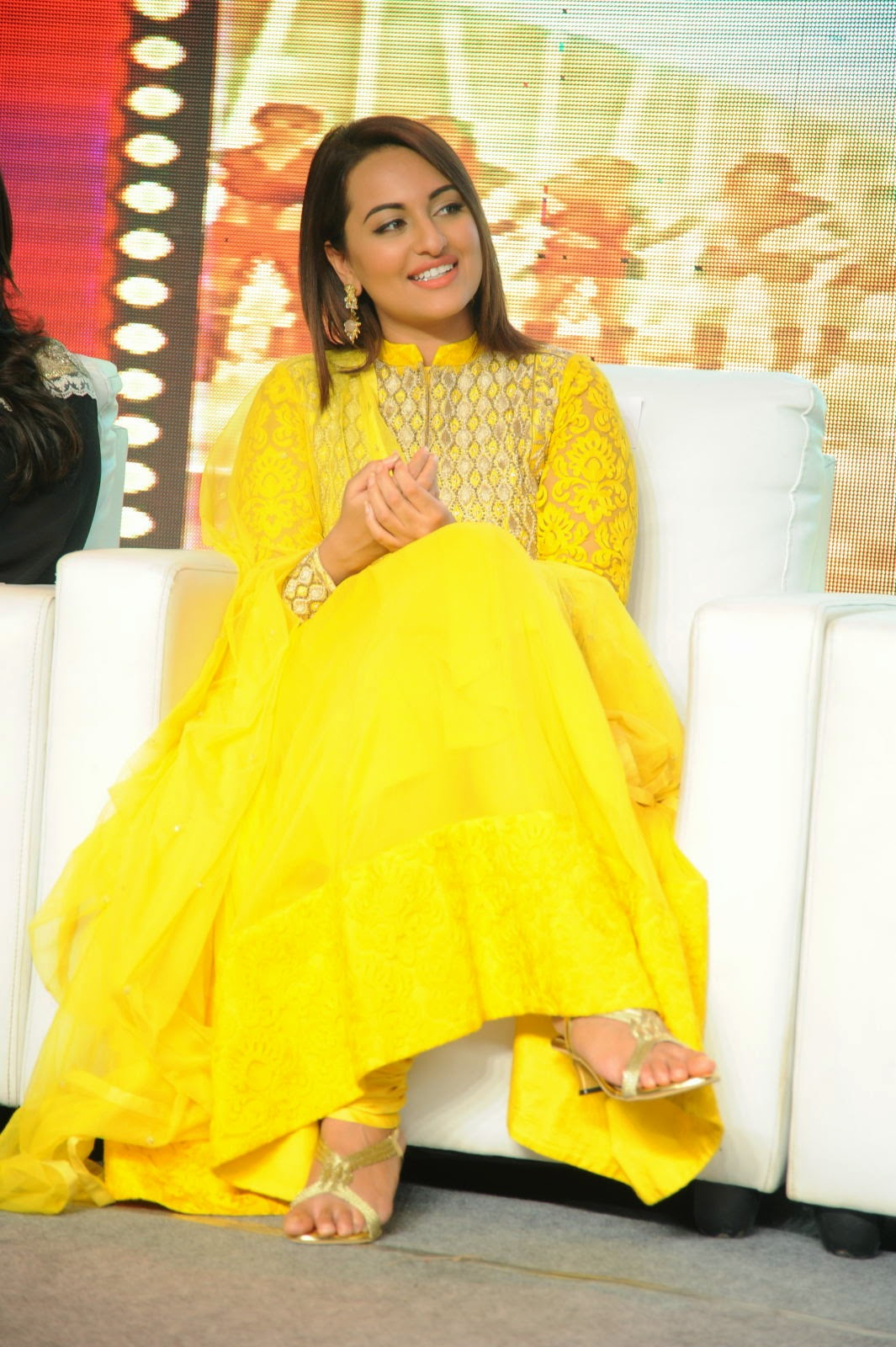 Sonakshi Sinha in yellow Salwar Kameez at Lingaa Event.