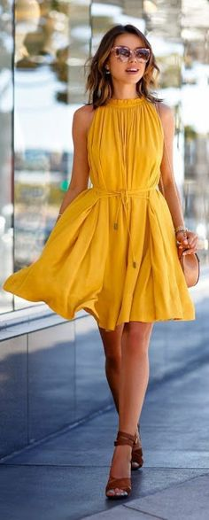 Mustard dress paired with brown wedges and camel sling bag.