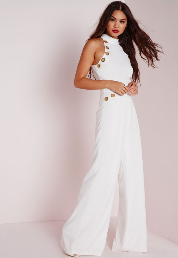 The model in white eyelet detail jumpsuit.