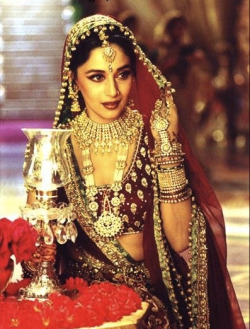 Madhuri Dixit wearing long bindi with Traditional Indian jewelry.