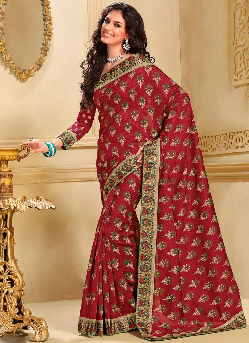 The model in lotus printed maroon art silk saree.