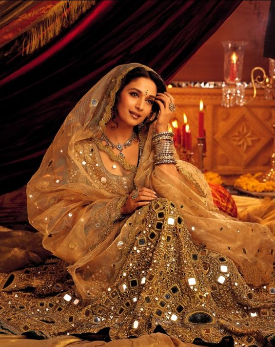 Madhuri Dixit in Mirror work embellished lehenga.