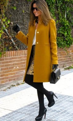 Overcoat paired with white shirt and a midi skirt