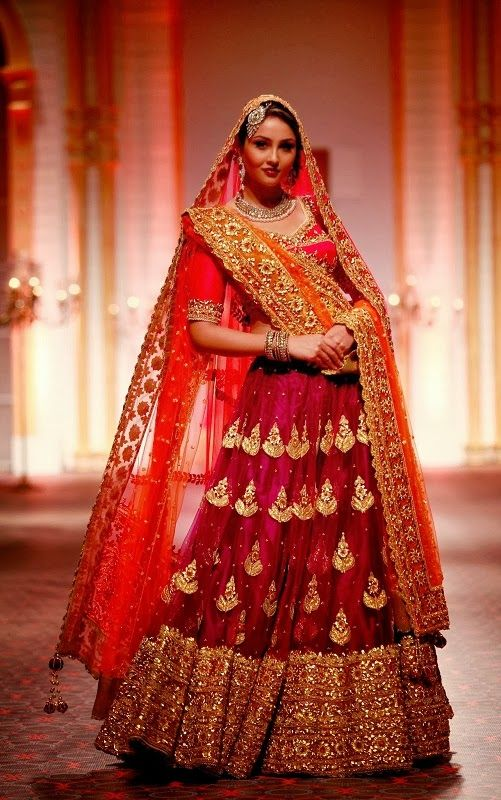 The model in red bridal Lehenga.