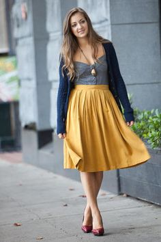 Midi skirt paired with grey top and blue cardign