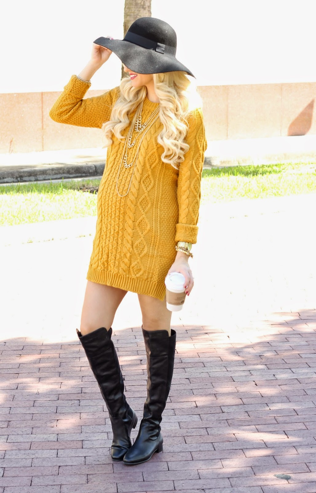 Sweater dress paired with knee high boots