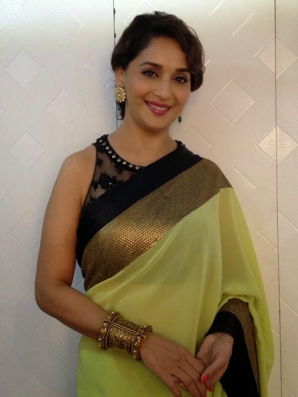 Madhuri Dixit in formal saree look.