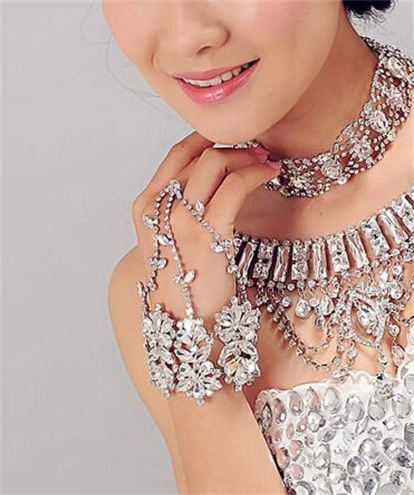 The bride flaunting her hand chain.