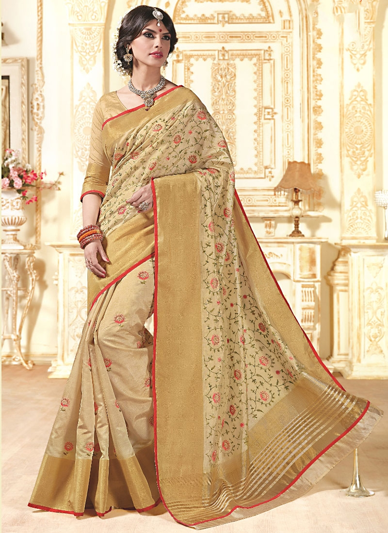 The model in Joyous Cream Tussar Silk Saree.