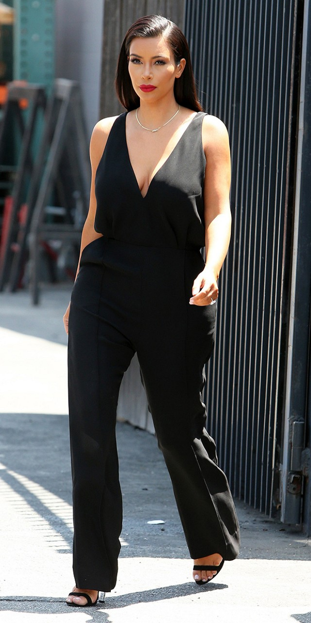 Kim Kardashian in black jumpsuit.
