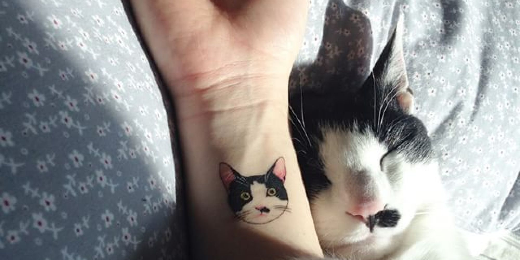 The model with a cat tattoo.