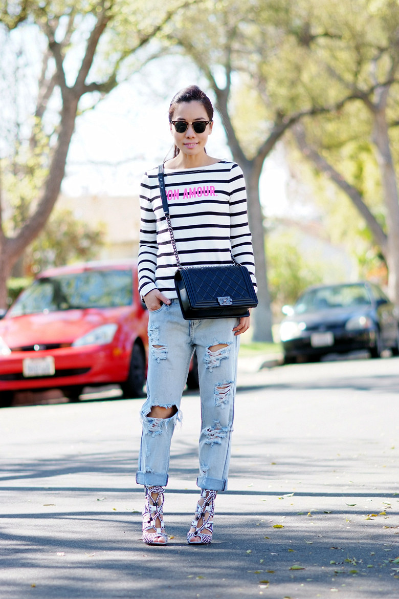The model in striped shirt and boyfriend jeans.