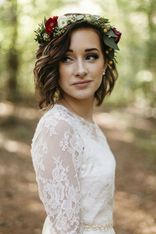 The model in Short hair with flower crown.