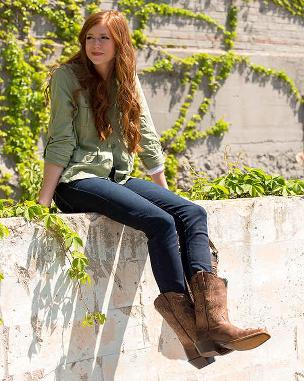 The model in Cowboy Boots with Skinny Full Length Jeans.