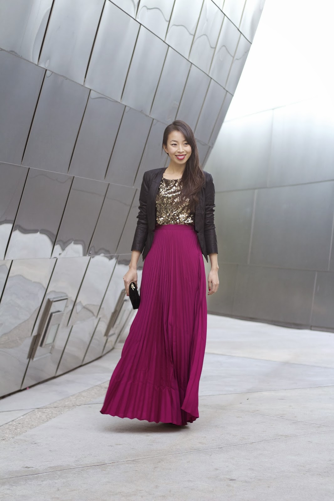 The model in black blazer with violet maxi skirt.
