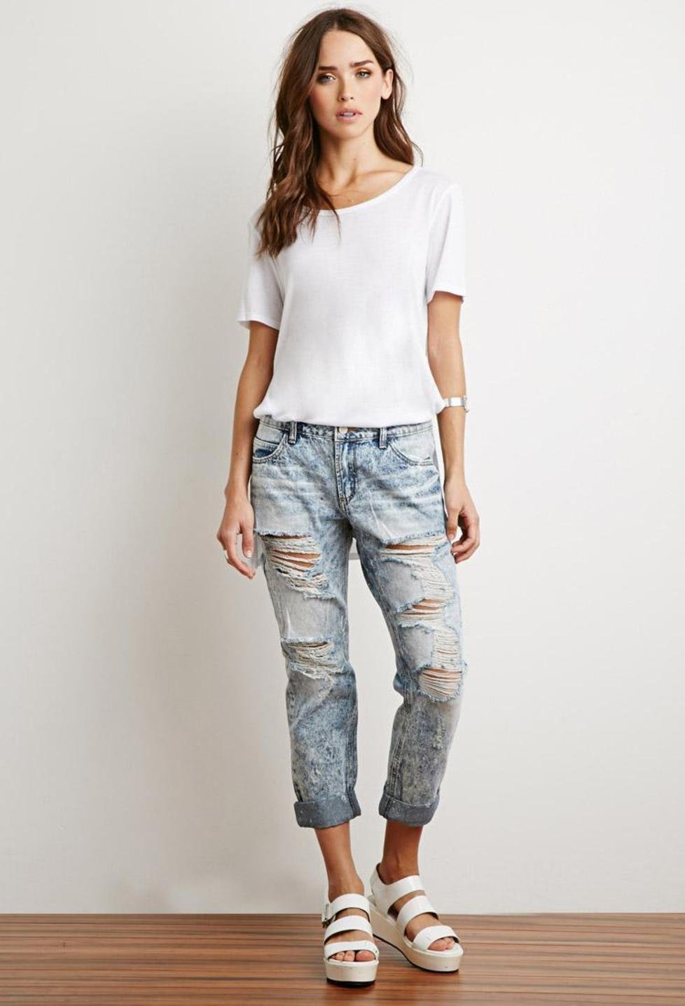 The model in Distressed Acid Wash Boyfriend Jeans.