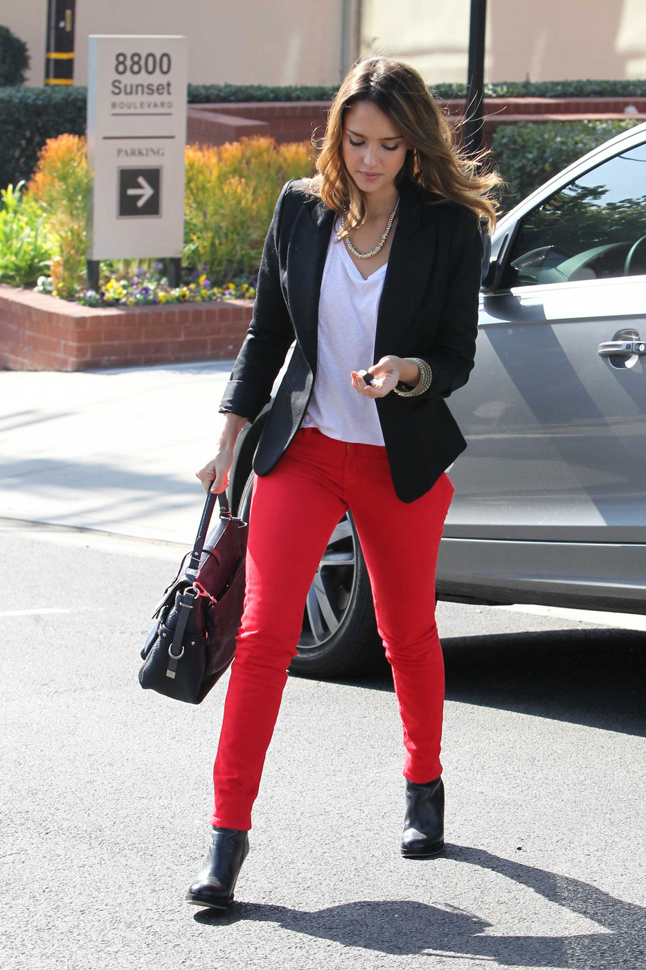 The model in blazer and red chinos.