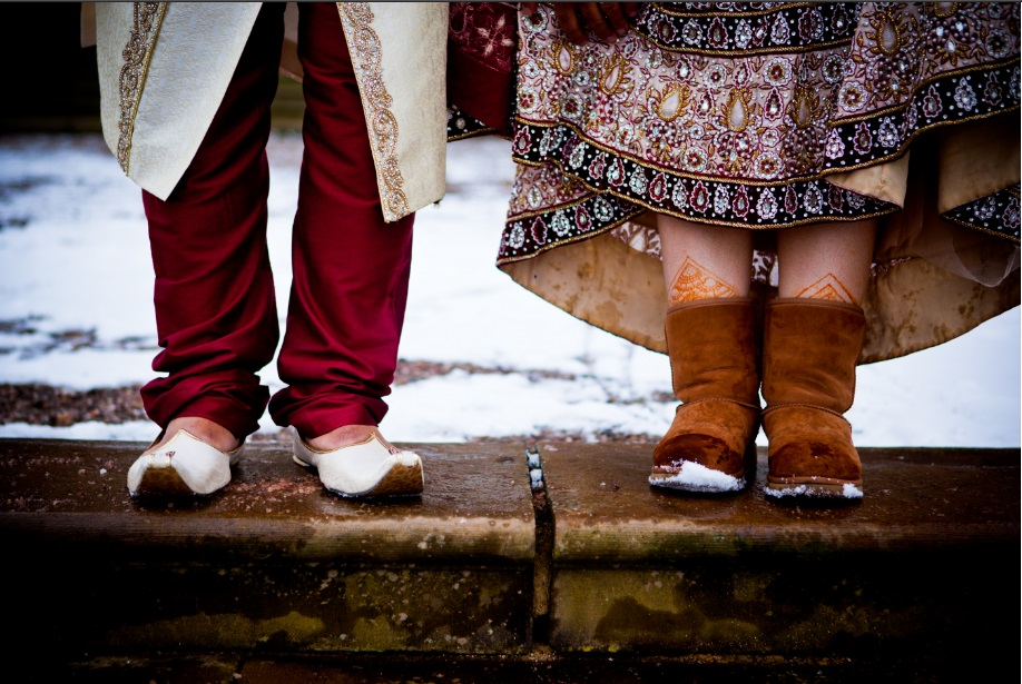 Indian couple wearing traditional dress with gorgeous shoes.