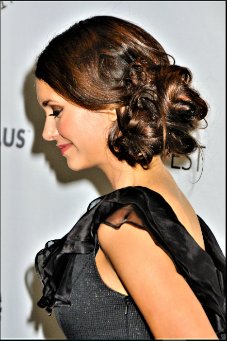 Nina Dobrev with Flirty Side-Swept Chignon.