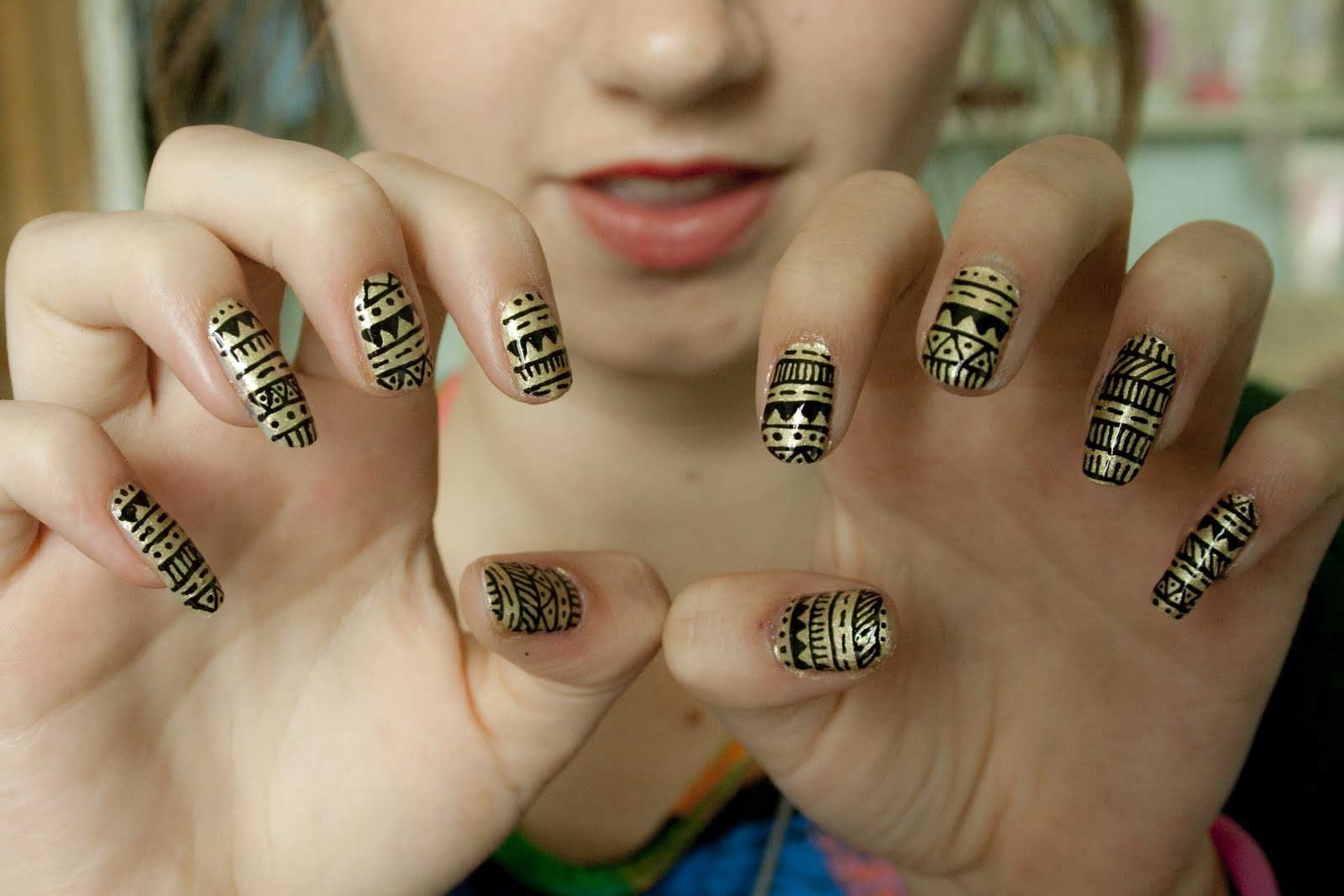 The girl with Black and Gold Aztec Nail Design.