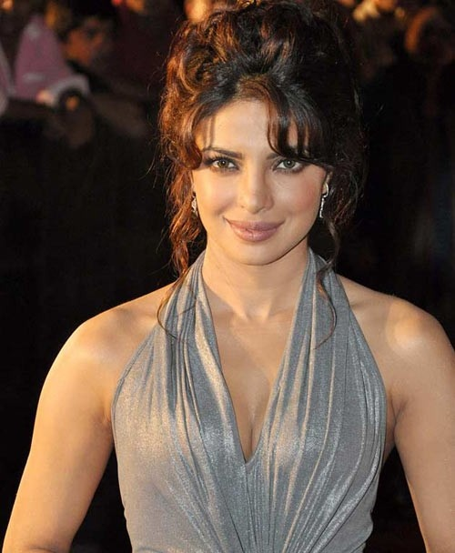 Priyanka Chopra can pull off any look and she has done it in this curly bun she looks sexy.