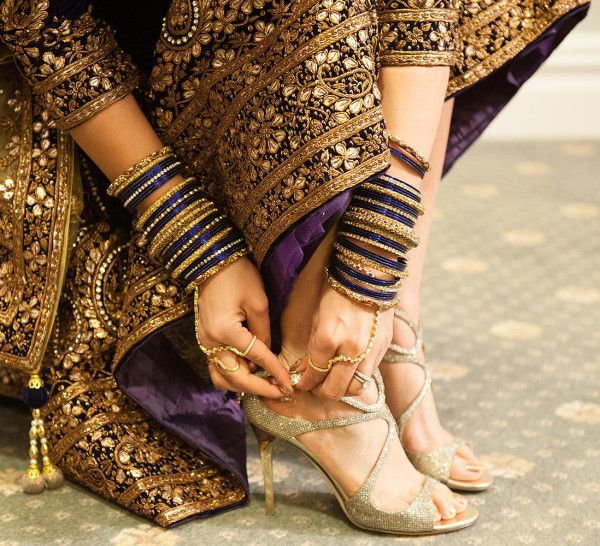 Indian Bride wearing wedding dress with matching sandals.