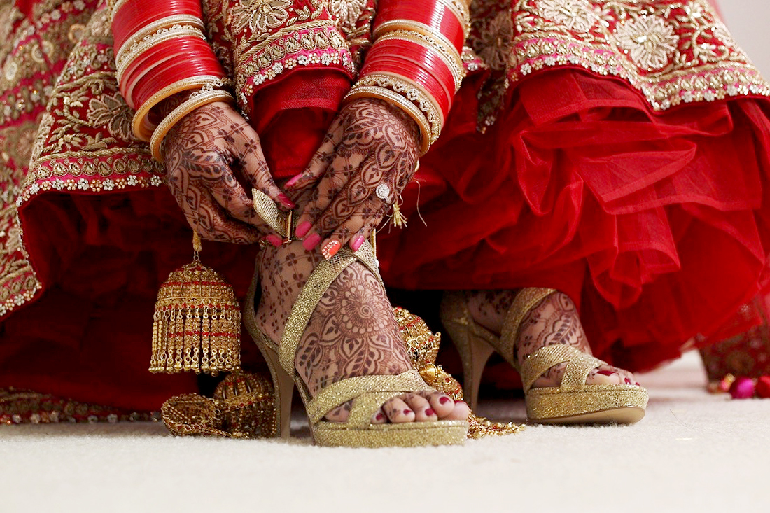 Indian Bride wearing high heels.