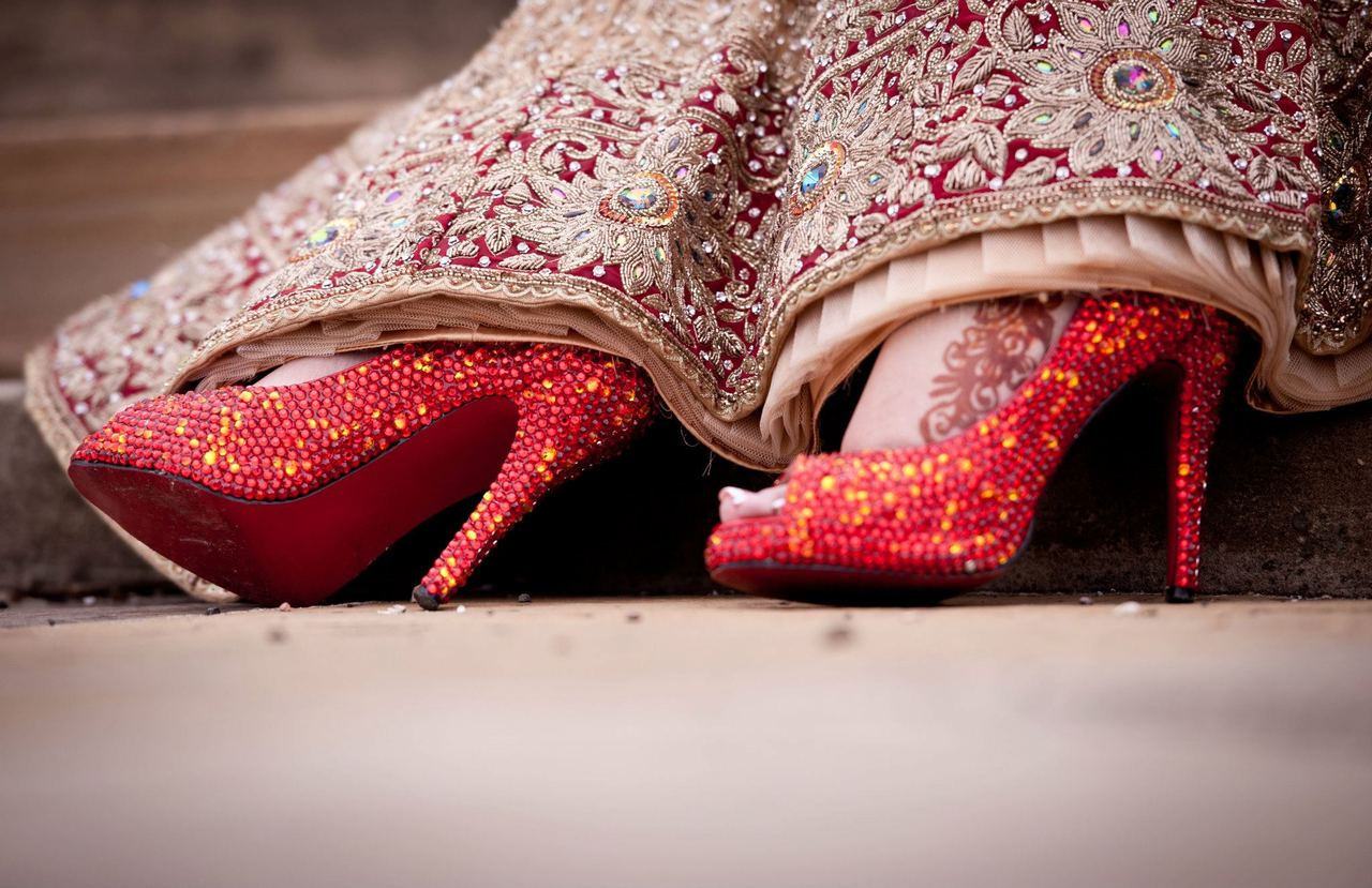 Indian bride wearing red shoes.