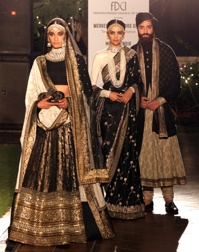 A rich banarasi ensemble with heavy gold and black tone by Sabyasachi Mukherjee