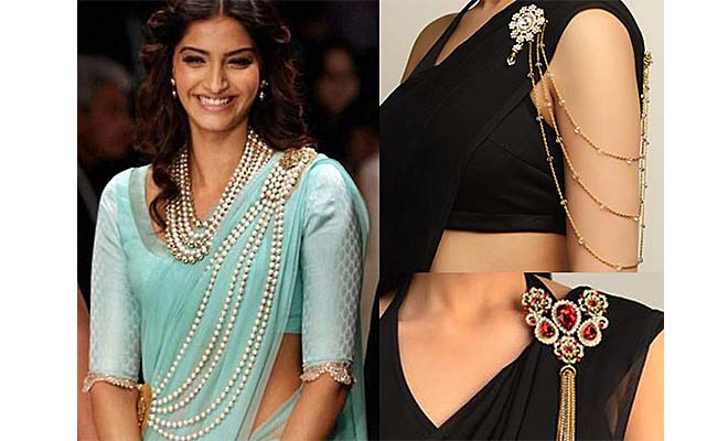 Sonam Kapoor wearing a saree with a brooch pin.