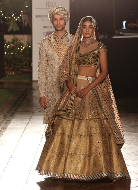 A wedding ensemble with a shimmer finishing by JJ Valaya