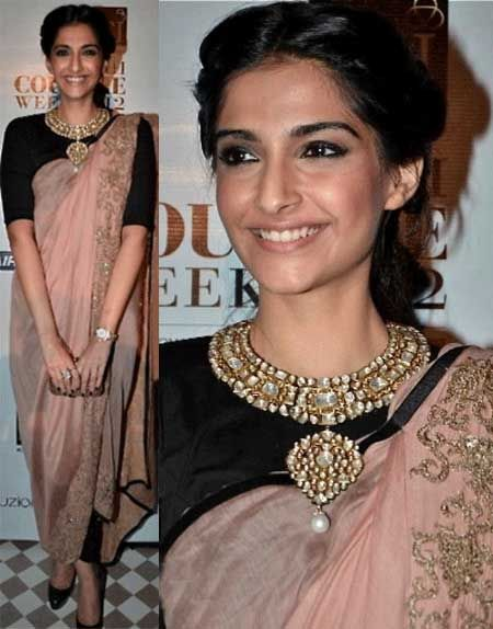 Sonam in Black plain blouse with choker necklace