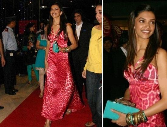 Deepika holding a clutch.