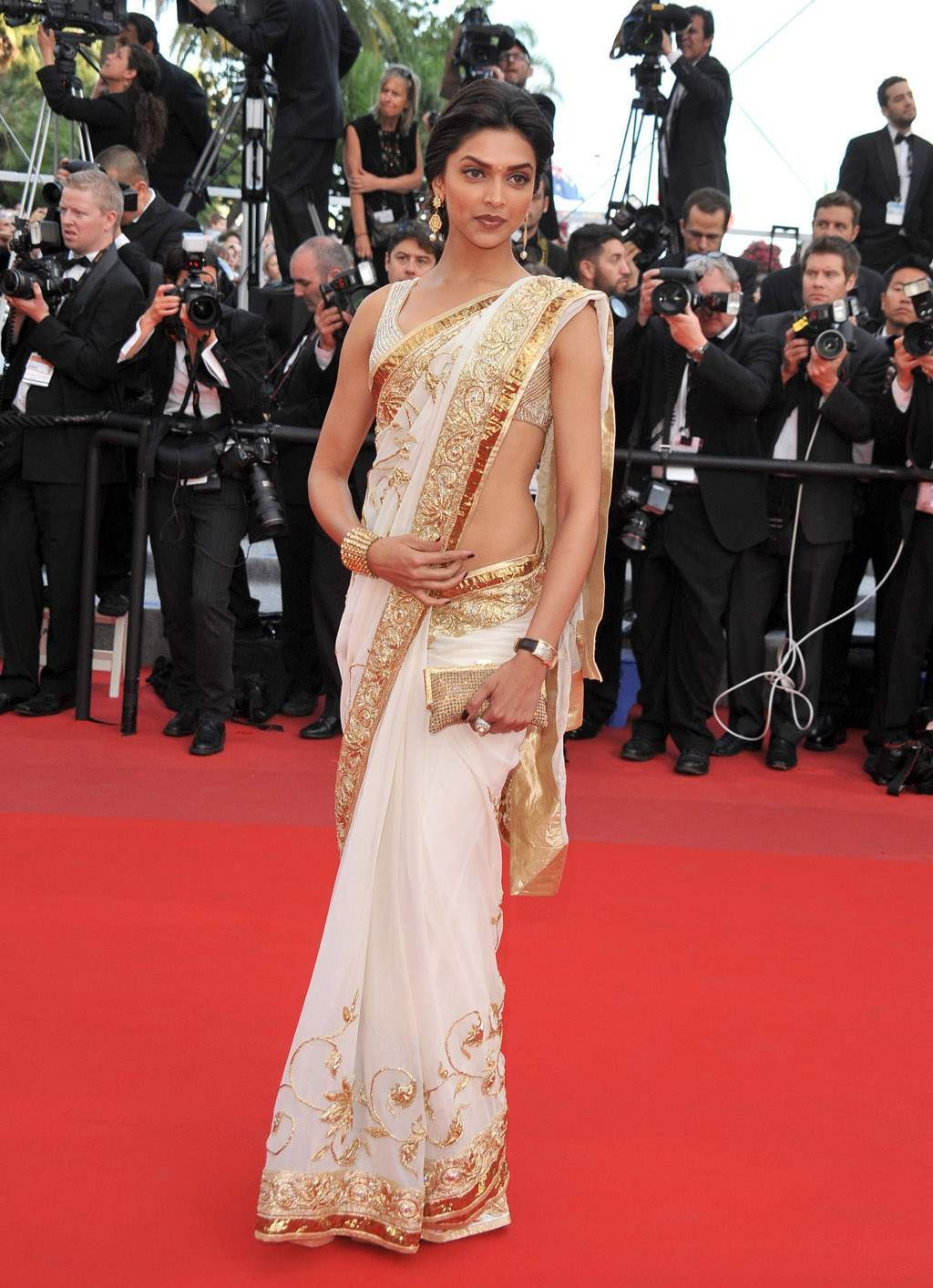 Deepika with a golden clutch to suit the occasion.