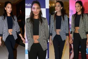 Lisa wearing Alexander Wang leggings with a Bebe crop top and Mason by Michelle Mason striped jacket