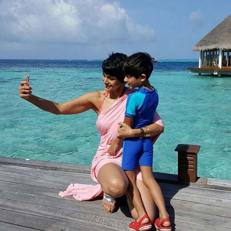 Taking a selfie with her son