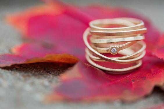 Multiple loop ring with gem