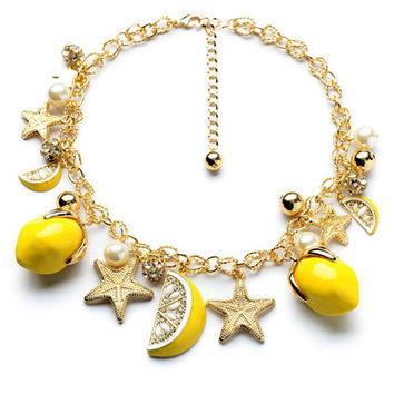 Fruit charms on bracelet