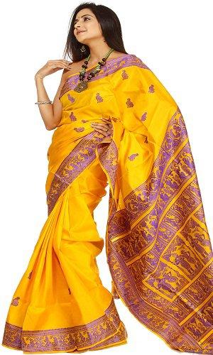 The model in yellow Baluchari silk saree.