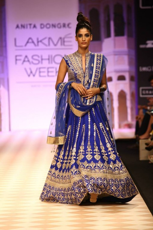 The model in blue bridal lehenga.