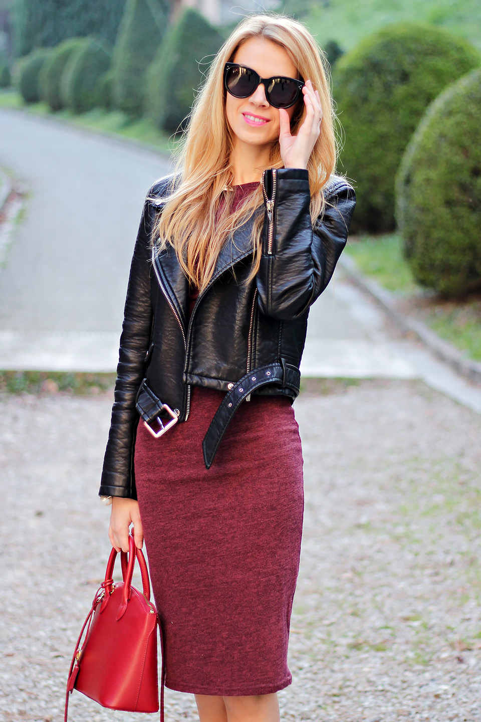 The model has paired her simple red bodycon dress with the jacket.