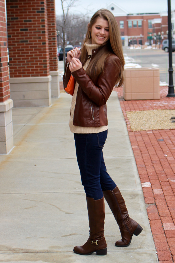 The model has paired her high neck top with the jacket.