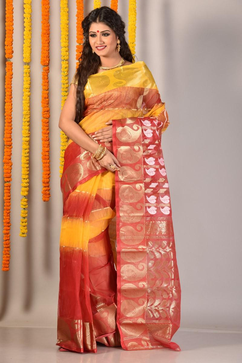 The model in designer tant saree.