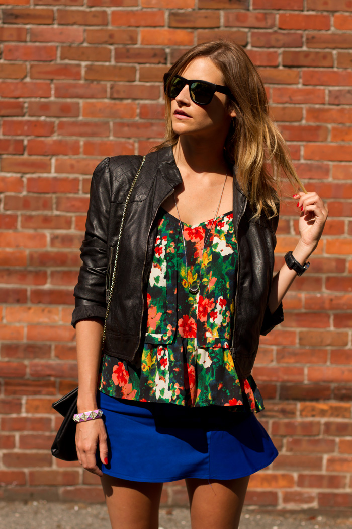The model in over-sized floral top with dark jacket.